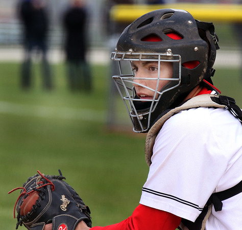 Batavia catcher Tyler Munoz looks toward the dugout for a sign during a game against visiting Geneva May 4.