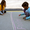 Wild Rose Elementary School second graders Elle Reynolds, left, and Alanna Gupta, right, draw the finish line for the fun run May 6 at Wild Rose Elementary's 50th anniversary celebration.  Families, students, alumni and teachers participated in the run/walk.