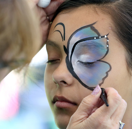 Alani Arredondo, 10, of Aurora has her face painted during the Loyalty Day Picnic at the Batavia VFW May 7.