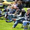 People watch and listen to the Batavia Community Band perform during the Loyalty Day Picnic at the Batavia VFW May 7.