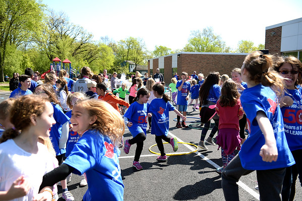 Wild Rose Elementary School students dance the Hoki Poki May 6 at the schools 50th anniversary celebration. The school opened in the fall of 1966.