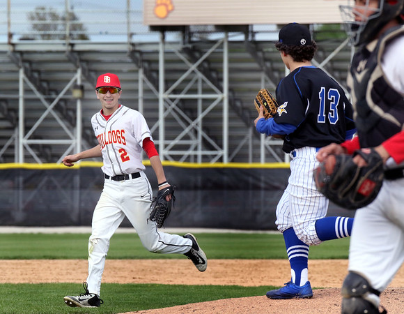 Batavia right fielder Anthony Carlini (#2) heads to the dugout between innings of a game against visiting Geneva May 4.