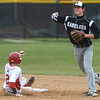 Kaneland senior Jack Marshall turns a double play as Yorkville's Lucas Farren slides in during their game May 9 at Yorkville High School.<br /> Mark Busch - mbusch@shawmedia.com
