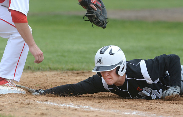 Kaneland senior Preston Havis dives safely back into first on a pickoff attempt during their game against Yorkville May 9 at Yorkville High School.<br /> Mark Busch - mbusch@shawmedia.com