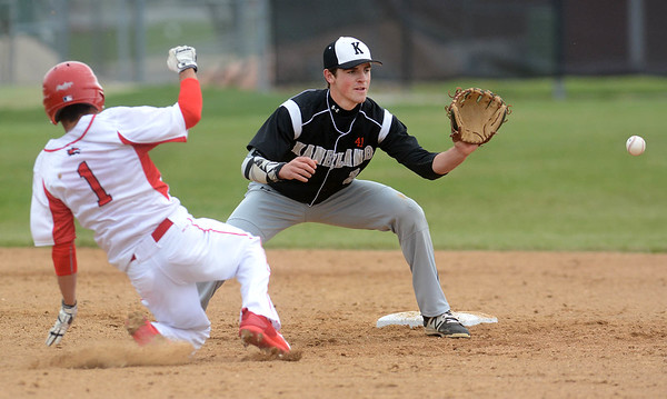 Kaneland senior Jack Marshall takes the throw as Yorkville's Luis Rodriguez slides into second during their game May 9 at Yorkville High School.<br /> Mark Busch - mbusch@shawmedia.com
