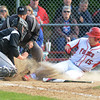 Yorkville junior Jonathon Jungr tries to score on a squeeze bunt but is tagged out by Kaneland's Josh Norman during their game May 9 at Yorkville High School.<br /> Mark Busch - mbusch@shawmedia.com