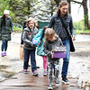 (From left) Alexa Schill, Donovan Malone, Tess Malone and Sheri Malone carry in donations for the Fox Valley Wildlife Center at the annual Wild Baby Shower April 30, in Elburn. The goal of the event was to raise donations of necessity items the center uses for helping animals that are brought to them for care.