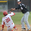 Kaneland senior Jack Marshall tries to turn two as Yorkville's Brendon Reifsteck attempts to break it up during their game May 9 at Yorkville High School.<br /> Mark Busch - mbusch@shawmedia.com