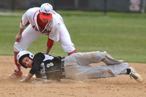 Yorkville senior Brendon Reifsteck puts the tag on Kaneland's Joey Brandonisio during their game May 9 at Yorkville High School.<br /> Mark Busch - mbusch@shawmedia.com