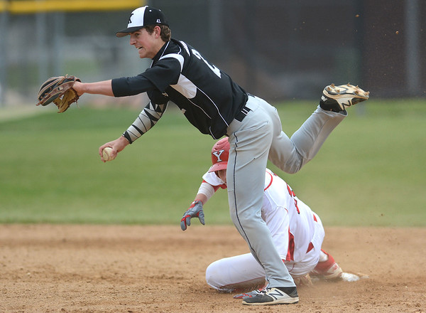 Kaneland senior Jack Marshall is tripped up by Yorkville's Brendon Reifsteck as he slides in hard to break up a double play during their game May 9 at Yorkville High School.<br /> Mark Busch - mbusch@shawmedia.com