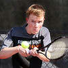 St. Charles East's Pete Clancy hits a return while competing for the Upstate Eight Conference #1 singles third place at St. Charles East High School May 13.