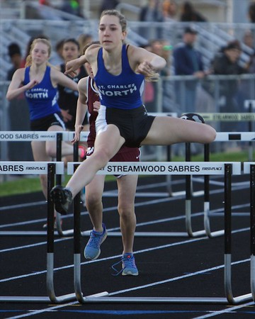 St. Charles North's  Arden Stapella competes in the 100 meter hurdle on May 11 th at Bartlett's class 3A Girl's sectional in Streamwood.