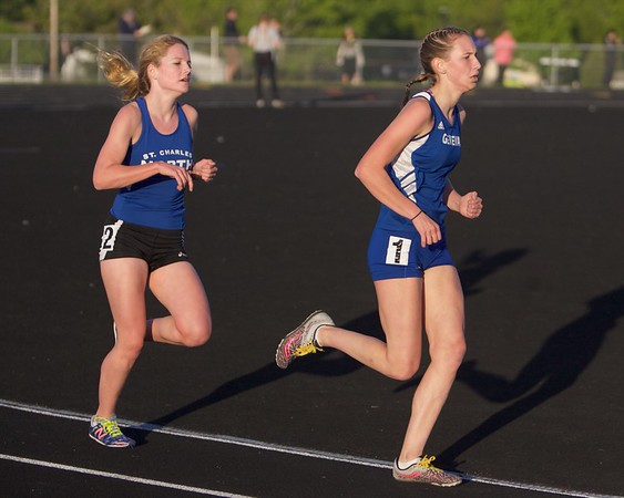 Geneva's Sophia McDonnell and St. Charles North's Audrey Ernst competes in the 3200 Meter run on May 11 th at Bartlett's class 3A Girl's sectional in Streamwood.