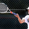 Batavia's Brogan Pierce hits a return while competing for the Upstate Eight Conference #1 singles championship at St. Charles East High School May 13.