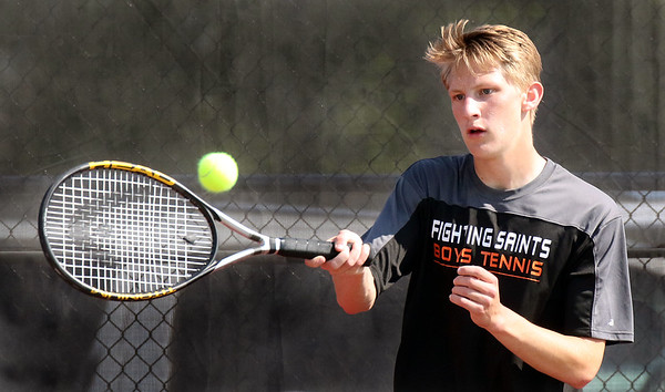 St. Charles East's Hunter McCue hits a return while competing for the Upstate Eight Conference #2 singles third place at St. Charles East High School May 13.