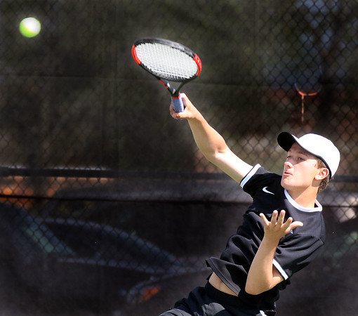 St. Charles North's Alex Gievlous hits a return while competing for the Upstate Eight Conference #1 singles third place at St. Charles East High School May 13.