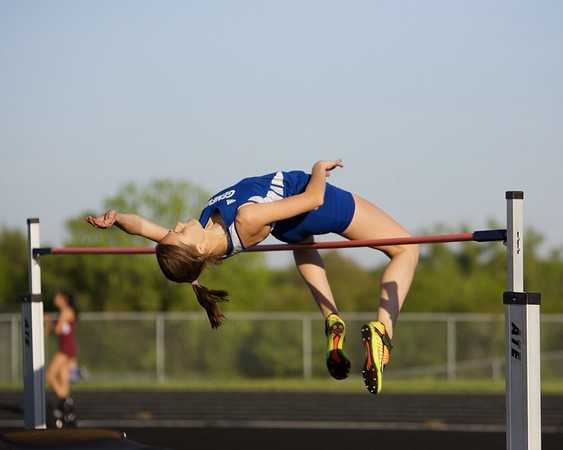 Geneva's Kristin Higgins competes in the high jump on May 11 th at Bartlett's class 3A Girl's sectional in Streamwood.