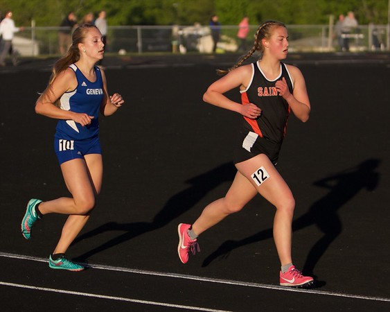St. Charles East's Hannah Ewald and Geneva's Emily Belanger competes in the 3200 run on May 11 th at  Bartlett's class 3A Girl's sectional in Streamwood.