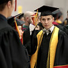 Batavia High School graduate Blake Bakkum prepares for the school's 2017 commencement ceremony at the Northern Illinois University Convocation Center in DeKalb May 24.