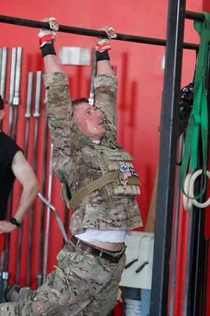 Bobby Kaye from St. Charles does pull ups on May 27 at CrossFit Tri-Cities during the 10th Annual Murph for Miller in St. Charles.