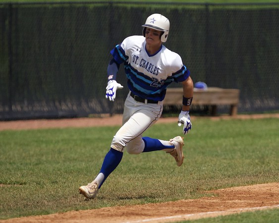 St. Charles North's Sam Faith heads for home against Glenbard North May 27 at the Class 4A Regional Championship game in St. Charles.