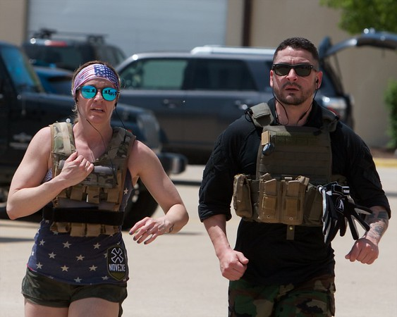 Alyson & Jose Favela from Wadsworth run 1 mile on May 27 at CrossFit Tri-Cities during the 10th Annual Murph for Miller in St. Charles.