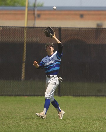 St. Charles North's Raph Rhoades camps under the ball for the out against Glenbard North on May 27 at the Class 4A Regional Championship game in St. Charles.