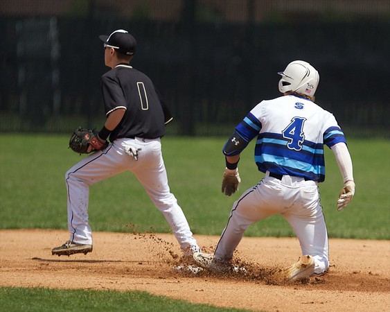 St. Charles North's Anthony Delisi slides in safely with a double before Glenbard North's Anthony Ferreri can apply the tag on May 27 at the Class 4A Regional Championship game in St. Charles.