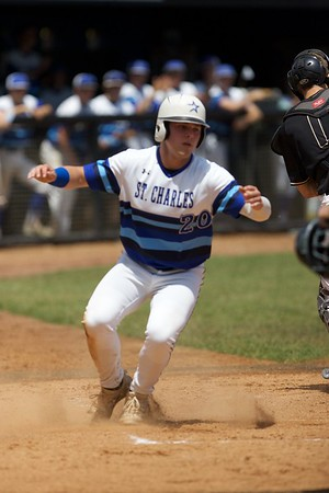 St. Charles North's Tyler Mettetal slides in safely against Glenbard North on May 27 at the Class 4A Regional Championship game in St. Charles.