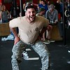 Rafael Rosario from Wheaton does air squats on May 27 at CrossFit Tri-Cities during the 10th Annual Murph for Miller in St. Charles.