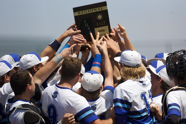 St. Charles North raises the championship plaque after defeating Glenbard North on May 27 at the Class 4A Regional Championship game in St. Charles.