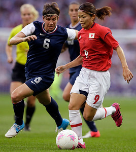 United States' Amy Le Peilbet (6), a 2000 Prairie Ridge graduate, defends Japan's Nahomi Kawasumi (9) during the women's soccer gold medal match at the 2012 Summer Olympics, Thursday, Aug. 9, 2012, in London. (AP Photo/Kirsty Wigglesworth)