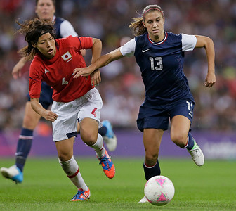 United States' Alex Morgan (13) moves the ball past Japan's Saki Kumagai (4) during the women's soccer gold medal match at the 2012 Summer Olympics, Thursday, Aug. 9, 2012, in London. (AP Photo/Kirsty Wigglesworth)