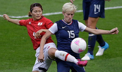 Japan's Nahomi Kawasumi, left, fights for control of the ball with United States' Megan Rapinoe during the women's soccer gold medal match at the 2012 Summer Olympics, Thursday, Aug. 9, 2012, in London. (AP Photo/Andrew Medichini)