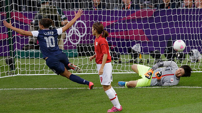 United States' Carli Lloyd (10) celebrates after scoring against Japan goalkeeper Miho Fukumoto (1) during the women's soccer gold medal match at the 2012 Summer Olympics, Thursday, Aug. 9, 2012, in London. (AP Photo/Andrew Medichini)