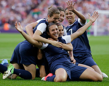 United States' Carli Lloyd, right, celebrates with teammates after scoring during the women's soccer gold medal match against Japan at the 2012 Summer Olympics, Thursday, Aug. 9, 2012, in London. (AP Photo/Ben Curtis)