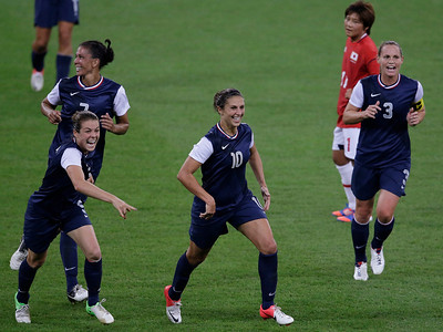 United States' Carli Lloyd (10) celebrates with teammates after scoring her second goal during the women's soccer gold medal match against Japan at the 2012 Summer Olympics, Thursday, Aug. 9, 2012, in London. (AP Photo/Andrew Medichini)