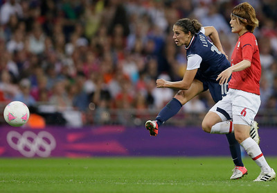United States' Carli Lloyd (10) shoots past Japan's Saki Kumagai to score her second goal during the women's soccer gold medal match at the 2012 Summer Olympics, Thursday, Aug. 9, 2012, in London. (AP Photo/Kirsty Wigglesworth)