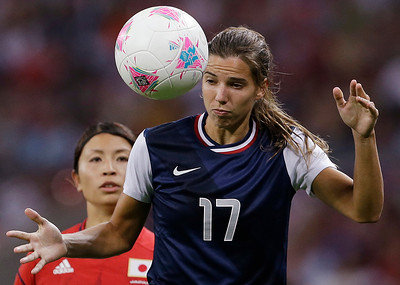 United States' Tobin Heath fights to control the ball against Japan during the women's soccer gold medal match at the 2012 Summer Olympics, Thursday, Aug. 9, 2012, in London. (AP Photo/Ben Curtis)