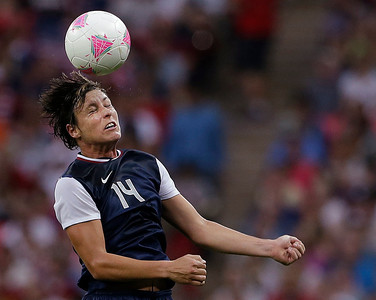 United States' Abby Wambach heads the ball during the women's soccer gold medal match against Japan at the 2012 Summer Olympics, Thursday, Aug. 9, 2012, in London. (AP Photo/Ben Curtis)