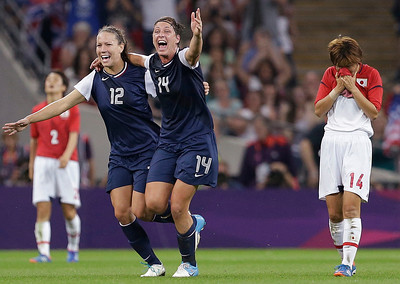 United States' Lauren Cheney (12) and Abby Wambach (14) celebrate as Japan's Asuna Tanaka (14) and Yukari Kinga (2) react after the United States won the women's soccer gold medal match at the 2012 Summer Olympics, Thursday, Aug. 9, 2012, in London. (AP Photo/Ben Curtis)