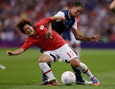 Japan's Shinobu Ohno, front, fights for control of the ball with United States' Shannon Boxx during the women's soccer gold medal match  at the 2012 Summer Olympics, Thursday, Aug. 9, 2012, in London. (AP Photo/Ben Curtis)