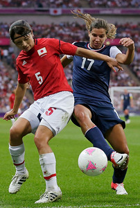 Japan's Aya Sameshima (5) and United States' Tobin Heath (17) fight for the ball during the women's soccer gold medal match at the 2012 Summer Olympics, Thursday, Aug. 9, 2012, in London. (AP Photo/Julie Jacobson)