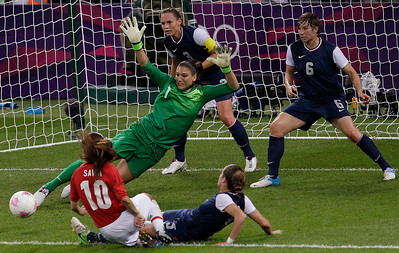 United States goalkeeper Hope Solo (1) makes a save against Japan as Amy Le Peilbet (6), a 2000 Prairie Ridge graduate, defends during the women's soccer gold medal match at the 2012 Summer Olympics, Thursday, Aug. 9, 2012, in London. (AP Photo/Andrew Medichini)