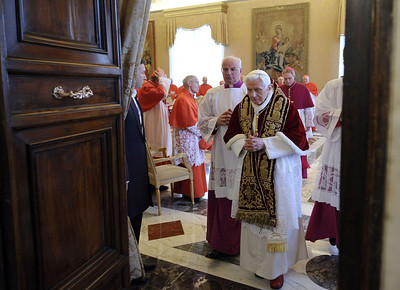 In this photo provided by the Vatican newspaper L'Osservatore Romano, Pope Benedict XVI, center, leaves after attending a meeting of Vatican cardinals where he read a document in Latin in which he announced his resignation, at the Vatican, Monday, Feb. 11, 2013. Benedict XVI announced Monday that he would resign Feb. 28 - the first pontiff to do so in nearly 600 years. The decision sets the stage for a conclave to elect a new pope before the end of March. (AP Photo/L'Osservatore Romano, ho)