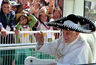 FILE - In this March 25, 2012 file photo, Pope Benedict XVI waves from the popemobile wearing a Mexican sombrero as he arrives to give a Mass in Bicentennial Park near Silao, Mexico. On Monday, Feb. 11, 2013 the Vatican announced that Pope Benedict XVI will resign on Feb. 28, 2013. (AP Photo/Eduardo Verdugo, file)