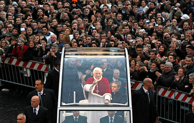 FILE - In this Tuesday, Dec. 8, 2009 file photo, Pope Benedict XVI, standing at center, waves from his popemobile on his way to the Spanish Steps in central Rome, for the traditional prayer before a statue of the Virgin Mary on the occasion of the Immaculate Conception. Benedict announced Monday Feb. 11, 2013 he would  resign Feb. 28, the first pontiff to do so in nearly 600 years. The decision sets the stage for a conclave to elect a new pope before the end of March. (AP Photo/Andrew Medichini. File)