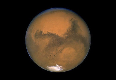 This  2003 image made available by NASA shows Mars photographed by the Hubble Space Telescope on the planet's closest approach to Earth in 60,000 years. NASAís robotic rover Curiosity landed safely on Mars late Sunday, Aug. 5, 2012 to begin two years of exploration. The mission cost $2.5 billion. (AP Photo/NASA)