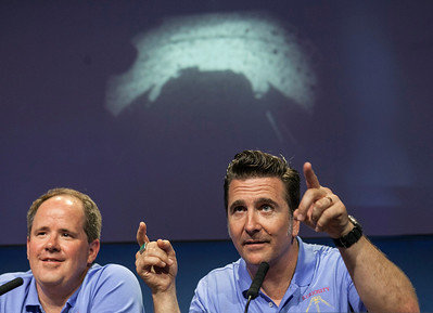 Mars Science Laboratory Curiosity Richard Cook, MSL deputy project manager, left, and Adam Steltzner, MSL entry, descent and landing (EDL) lead, right, point to the first image taken by NASA's Curiosity rover, which landed on Mars the evening of Aug. 5 on the surface of Mars, during  a news conference at NASA's Jet Propulsion Laboratory in Pasadena, Calif., Sunday, August 5, 2012. (AP Photo/Damian Dovarganes)