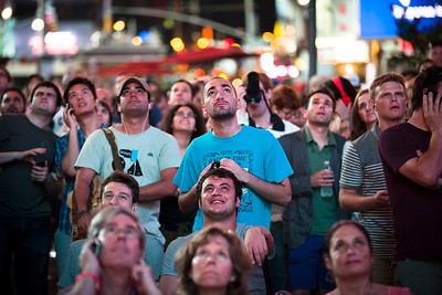 Facundo Lucci, 22, of Philadelphia, center, watches a live stream of the Mars Curiosity landing along with hundreds of other spectators in Times Square, August 6, 2012, in New York. After traveling 8 1/2 months and 352 million miles, Curiosity landed on Mars Sunday night. (AP Photo/John Minchillo)
